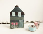 Tiny HOUSE brooch. Ocean green, aqua and black with a bed of pink tulips