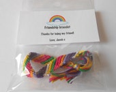 Party favor packs of friendship bracelets with personal message