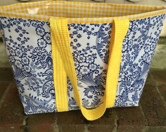 The Monet bag in inky blue toile and sunshine yellow gingham oilcloth