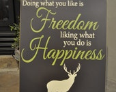 Doing what you like is freedom, liking what you do is happiness vinyl lettering wood sign