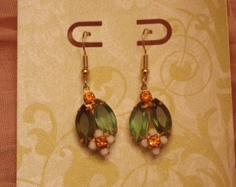 Vintage clip earrings converted to pierced. Beautiful green and orange glass circa 1960.