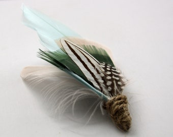 SCOUT'S HONOUR Feather Boutonniere in Aqua Mint, Moss Green, and Blush Pink with Black and White Stripes and Dots