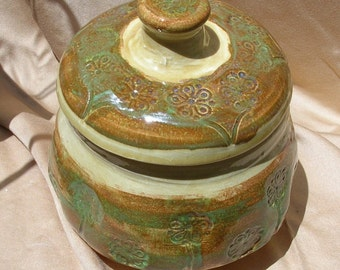 Embossed lidded jar or cannister