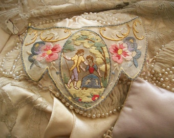 Antique embroidered applique on cotton organdy