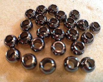 6mm smooth round bead with 3mm hole. Gunmetal plated, 25 pk NICKEL FREE
