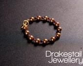 Bronze pearl & garnet bra...