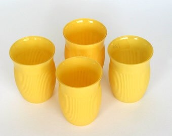 Four Fired-On Yellow Juice Glasses