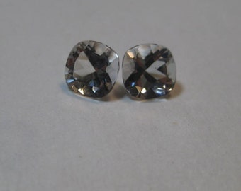 Topaz  faceted gemstones ....   2 pieces..  5 mm cushion shape  x 3 mm tall ...............     a4075