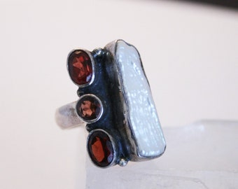 Vintage garnet and pearl ring. UK size O.  US size 7 1/4.  Sterling silver