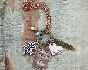 With a heart full of hope and lives to save, the mixed metal nurse necklace with cute bronze syringe & nurse charm