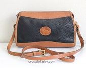 Dooney and Bourke Black Pebble Leather and Tan color Leather Trim  Cross Body Shoulder Bag , Item No. 142481