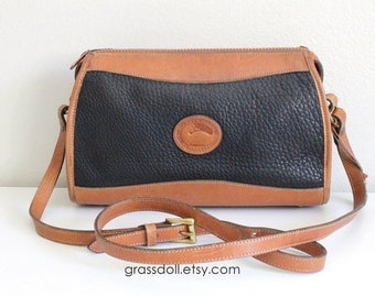 Dooney and Bourke Black Pebble Leather and Tan color Leather Trim  Cross Body Shoulder Bag , Item No. 142482