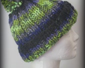 Beautiful lime green blue black and lavender hand knit pom pom hat
