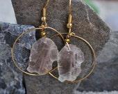 micah in gold hoop earrings
