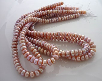 Pale pink/ mauve center drilled button pearls 5-5.5mm 1/2 strand
