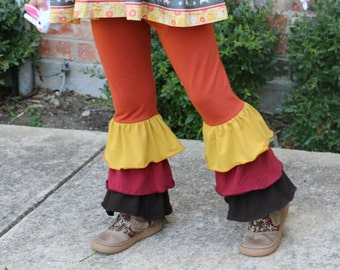 rust ornge triple ruffle leggings with yellow, marroon, and brown ruffles sizes 12m - 14 girls