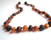 Maximum Effective Raw Unpolished Baltic Amber teething necklace for your baby handmade knotted .Cognak and cherry amber.