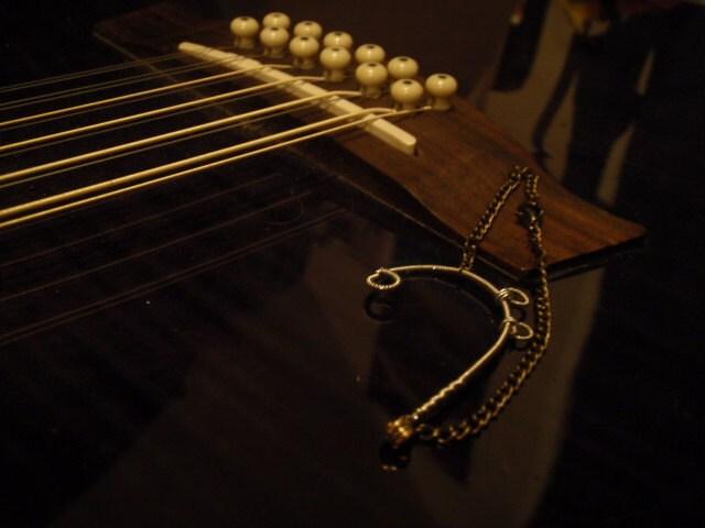 upcycled guitar string bass clef bracelet. Black Bedroom Furniture Sets. Home Design Ideas