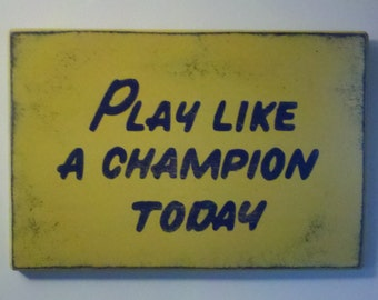 """Play Like a Champion Today Sign     12""""x18"""" - Distressed finish  *Officially Licensed Product*"""