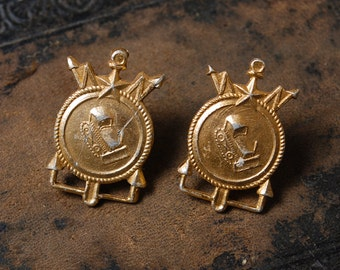 Vintage metal pins. Part of military uniform shoulder strap.