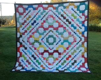 Bow tie, quilt is made with hundreds of different colors bow ties.