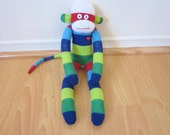 Rugby stripe sock monkey plush - red, green, navy blue, and white