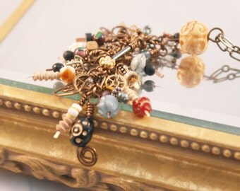 Knick-knackery Kittangle Kascade OOAK glass, bone, shell, plastic and wood beads on a bronze-colored chain