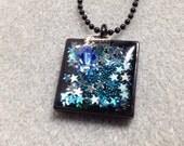 Glittering stars resin pendant