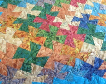 Mult-color twister quilt for a baby.