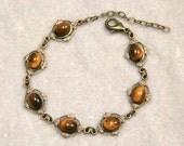 Tiger's Eye cabochon antiqued brass floating leaf bracelet
