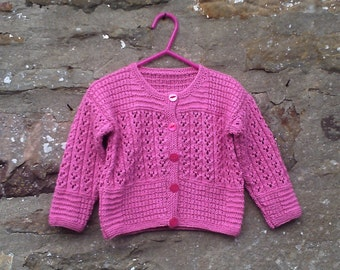 "Hand knitted little girl's pink lacy cardigan. 22"" chest"