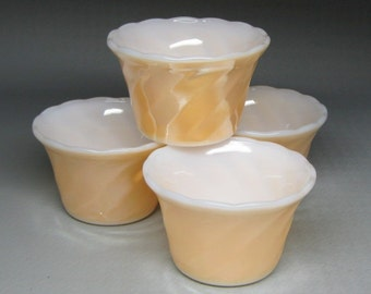 set of four FIRE KING custard bowls peach copper tint color swirl