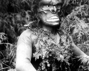 Dancer representing Paqusilahl, wild man of the woods.