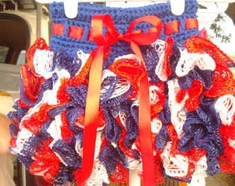 12-24 month ruffle tutu skirt in red, white, and blue with red ribbon