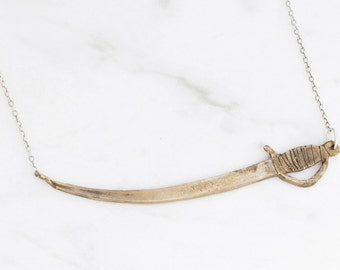 Sword necklace - brass on silver