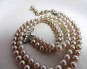 1940s Costume Jewelry: Necklaces, Earrings, Brooch, Bracelets Vintage Pearl Necklace Double Strand Necklace 1940s Champaign Colored Glass Pearl Necklace Costume Jewelry Costume Pearls $46.00 AT vintagedancer.com
