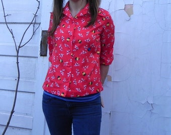 cute red blouse with flowers. small medium