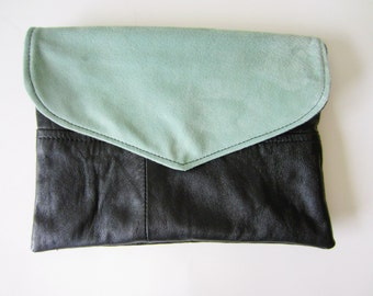 black leather clutch with reversible flap in dusty mint and black leather