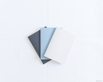 Pastel set of beige, blue and black handmade notebooks (journals)