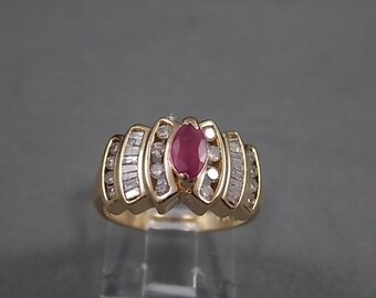 1980s Ruby and Diamond Ring 1.38Ctw Yellow Gold 14K 5.7gm Size 7 Engagement Wedding