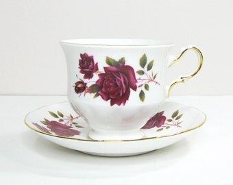 Vintage Queen Anne tea cup and saucer with velvet red rose gold trim - Footed red rose teacup