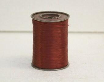 Large vintage spool Burgundy acetate fiber