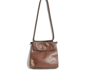 dark brown leather shoulder bag