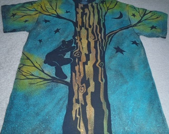 Baby black bear climbing a tree to watch the stars, what could be cuter, man's medium discharge t-shirt with procion dyes, turquoise, yellow
