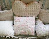 three rosebud chenille pillows
