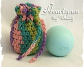 EOS Lip Balm Holder / Drawstring Bag with Key ring.  Hand crocheted.  Variegated purple, peach, teal and green.  Fits EOS or anything small.