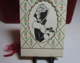 Gorgeous art deco 1930's die cut gold gilded Gibson Christmas bridge tally card Silhouette of framed victorian dressedlady, holly berry