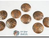 Set of Six Patterned Copper Discs