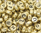Gold tone and black mixed letter beads, 500 7mm flat