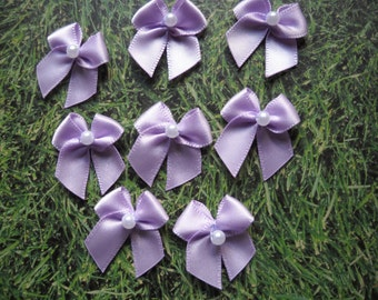 Mauve/ lilac satin ribbon bows, embellishment with faux pearl bead. Set of eight. Other colors available. 1 inch